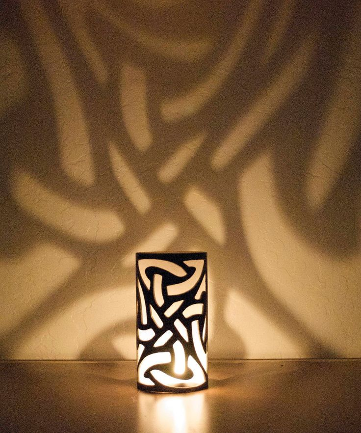 Celtic knot candle holder. I could probably reproduce this with glass paint and a pillar candle holder!