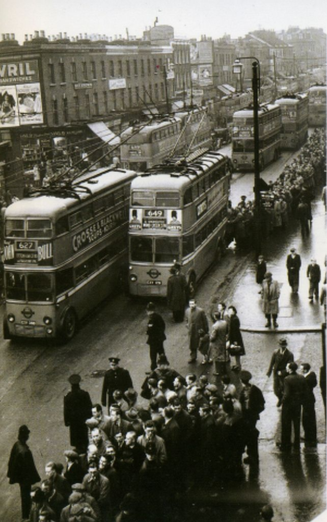 A whole fleet of trolleybuses are pictured here ferrying the football crowd away from Spurs ground at nearby White Hart Lane. There were double rows of wires to facilitate overtaking.