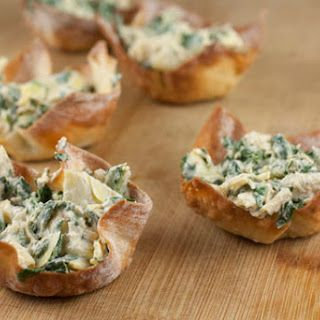 Spinach Artichoke Cups - 8 ounces light cream cheese (softened) 1/4 cups mayonnaise 1/2 cups grated parmesan cheese 3 garlic cloves (minced) 1 pinch salt 14 ounces artichoke hearts (drained and roughly chopped) 10 ounces frozen chopped spinach (thawed and drained) 2 dough (tubes of crescent roll)