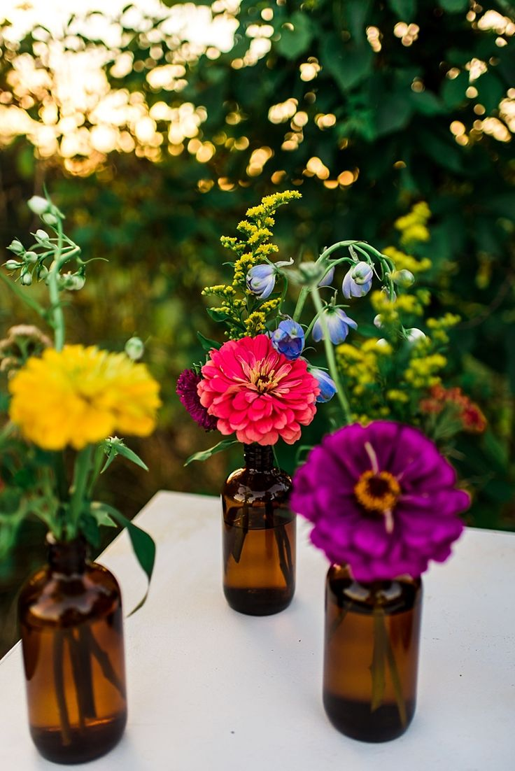 Multicoloured Florals Red Yellow Purple Brown Glass Vases Ethereal Boho Wedding Ideas http://perfectcapturephoto.com/