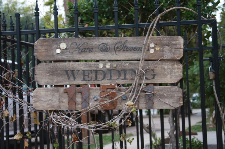 Old fence boards used to make a wedding sign with rusty metal numbers...made by Stephanie Quisenberry