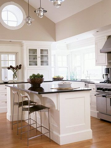 Notice the big vaulted ceiling and still using the hanging lamps. You can do that. Like countertop and white cabinets too