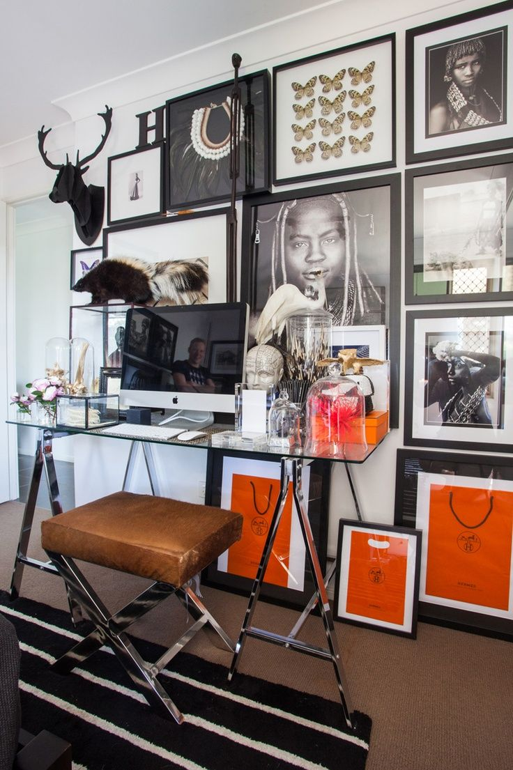 a great gallery wall with framed Hermes shopping bags!
