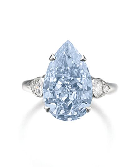 IMPORTANT FANCY INTENSE BLUE DIAMOND RING The pear-shaped modified brilliant fancy intense blue diamond weighing 5.51 carats, claw-set between pear-shaped motifs composed of brilliant-cut diamonds