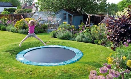 More bounce to the ounce: Sink a trampoline into the ground and it's both less intrusive from a grown-up's perspective and a safer piece of kit for children. Photograph: Rachel Warne