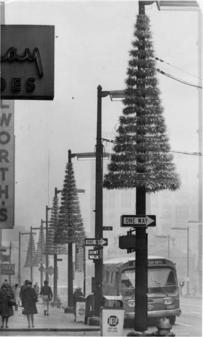 """Euclid Avenue, Musical Christmas Tree Decorations Cleveland Ohio, U.S.A. 1966 -""""Two 50-foot high musical trees with strings of twinkling lights activated by Christmas carols will dominate downtown Cleveland during the holiday season. Voices of carolers singing on the square will operate the lights on the two musical trees. Base voices will set red lights twinkling; mid-range voices will trigger blue lights and treble voices will make the green lights glow."""