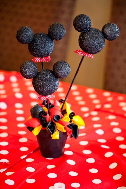 Mickey mouse birthday decor- DIY spray painted foam balls, stuck together with tooth picks, wood stick, and placed in flower pot with balloons