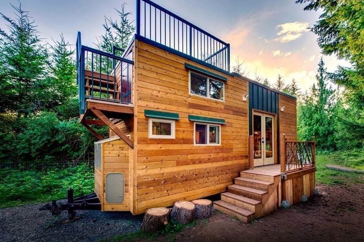 Tiny house with wood siding and roof deck