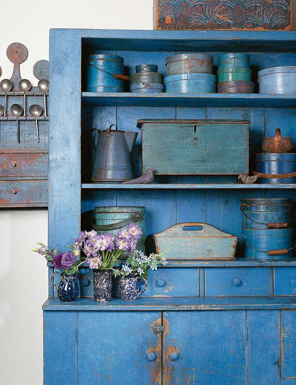 Organized by color and in perfect context, primitive boxes and containers in varying shades of blue turn a cornflower-blue hutch into a breathtaking showpiece.  (Photo: Jessie Walker)