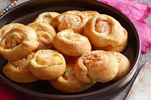 Jalapeno Popper Pinwheels recipe  1pkg.  (8 oz.) PHILADELPHIA Cream Cheese, softened1/2cup  KRAFT Shredded Triple Cheddar Cheese with a TOUCH OF PHILADELPHIA1large  fresh jalapeño pepper, seeded, finely chopped1can  (8 oz.) refrigerated crescent dinner rolls