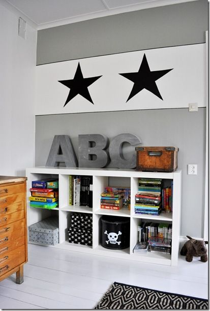 Black, white and wood kids room--perfect for an older boy--love the skull crossbones accent!