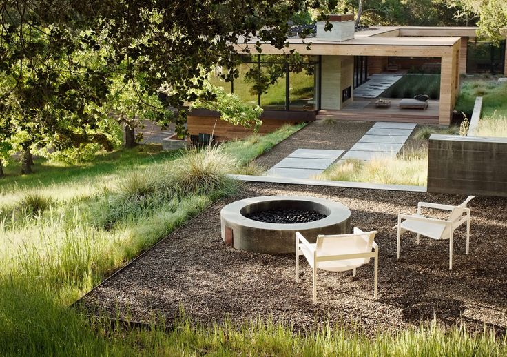 Afire pit is pretty much all you need to createan outdoor room. Pull up a few chairs (or rocks) for seating, and you suddenly have a new living space—wit