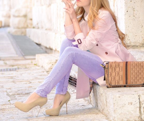 pink coat jeans high heel and purse