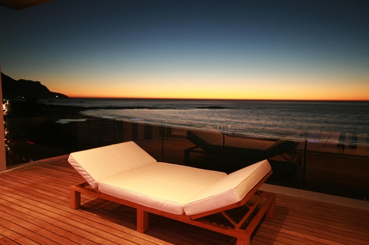 Take in the gorgeous sunset and sweeping sea views from your private balcony at 15 Views, Camps Bay.