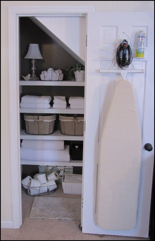 I'm not quite sure why I haven hung the iron and ironing board in my linen closet sooner. It seems like a logical place to put it. Doing that tomorrow!