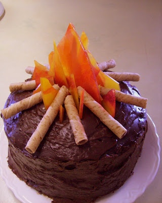 Summer Bliss Campfire Cake.  Remember how to melt peppermints into a hard tray from Christmas? Use cinnamon and butterscotch for flames.