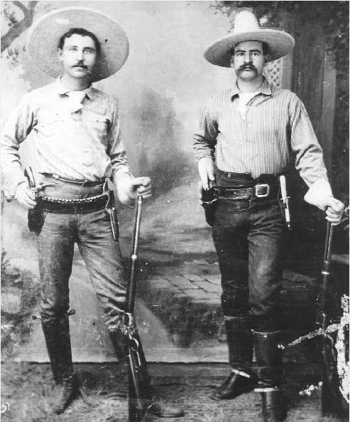 Texas Rangers George Black and J.M. Britton. Both served in Company B of the Frontier Battalion after the Civil War.