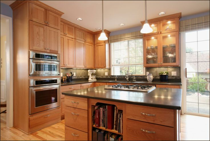 Shaker Style Kitchen (Cultivate.com)...maple cabinets with light blue walls...like