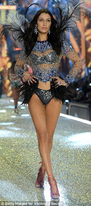 All that glitters... Bella's body was adorned with a glittering top and matching briefs as...