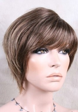 Wigs Online Synthetic Wig. A gorgeous Pixie Style wig with soft layers. This Modern Piece Features A Side Skin Top Part.  Colour 24BT18 - Ash Brown With Golden Blonde Tips.