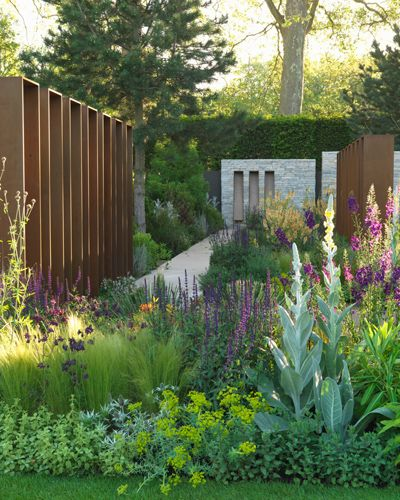 Lovely contrast between the wild abundance of the perennial garden and the form and structure of contemporary sculpture.  Design by Andy Sturgeon.