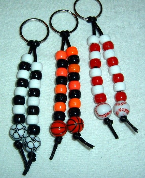 These are keychains made from pony beads and a sport ball bead -- basketball, baseball, and soccer -- strung on rattail ribbon, with a 1