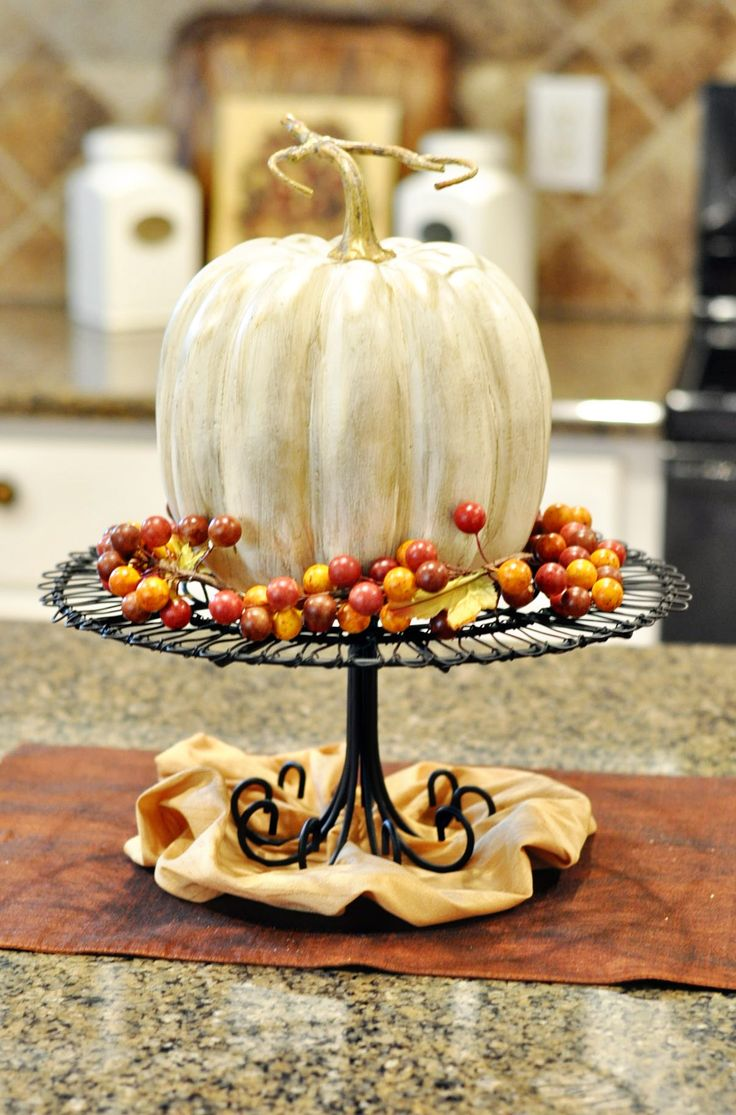 Pumpkin centerpiece... Spray paint pumpkins white, then brush with watered-down metallic paint.