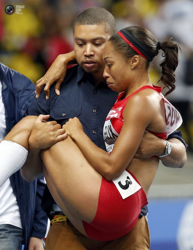 Felix of the U.S. is carried off the track by her brother Wes Felix after suffering an injury in the women's 200 metres final during the IAAF World Athletics Championships in Moscow. MAXIM SHEMETOV/REUTERS