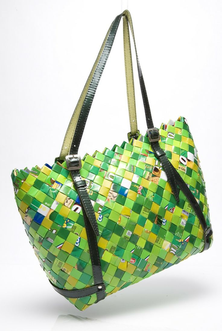 """14.5"""" x 10.5"""" x 5"""" Shoulder Bag made out of gum and candy wrappers.  ♦ Nahui Ollin - bags, wallets, etc. made from woven candy wrappers, old street maps, clipped bar codes, newspaper comics, etc. (original source - http://www.nahuiollin.com/handbags/shoulder-bags/twenty-4-seven-flavors-pink-berry-552.html )"""