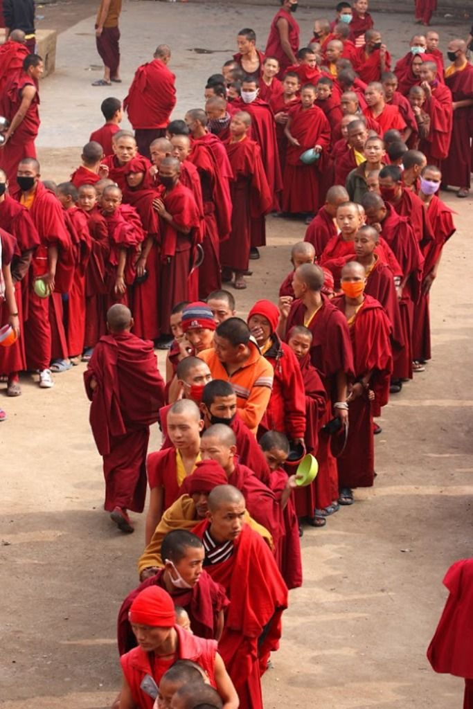 Bodh Gaya, Bihar Start, India (possibly a food line, maybe after some type of disaster, some are wearing masks over their mouths)