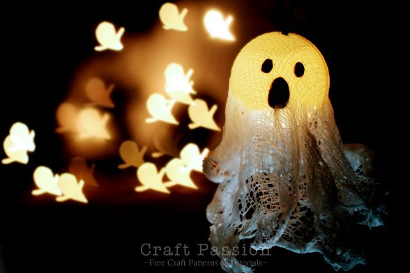 How to make Halloween Ghost Lights for the porch or your harvest tree using a string of lights, PVA Glue, cheese cloth and some ping pong balls. Fun craft idea for the holiday.