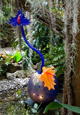 """DALE CHIHULY CLOISONNE BLUE IKEBANA WITH ORANGE AND COBALT FROG FEET, 2002 55 X 29 X 16"""" MAY 10, 2007 - FEBRUARY 24, 2008 PHIPPS CONSERVATORY PITTSBURGH, PENNSYLVANIA"""