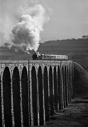 "Ribblehead 46229 steams across Ribblehead Viaduct, bearing the ""Royal Scot"" headboard...photo taken on October 19, 1985, Chapel le Dale, England, GB"