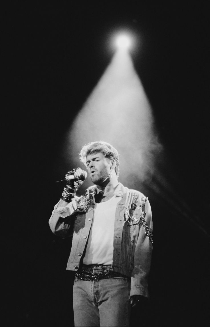 """Like many Americans, I first saw George Michael when he came blasting onto MTV alongside Andrew Ridgeley, in Wham!, in 1984. They wore white pants and white """"choose life"""" T-shirts, nearly glowing on a white stage, singing """"Wake Me Up Before You Go-Go,"""" and it was utterly dazzling, a little baffling. """"Jitterbug."""" Snap, snap. """"Jitterbug."""" Snap, snap."""