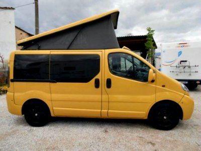 Homemade pop top camper on Renault van.