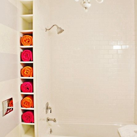 Even the smallest nooks and crannies can be put to good use as this reader did by creating a ceiling-height towel rack between wall and tub. | 2013 Reader Remodel ContestGuest Bathroom, House Ideas, Towels Cubbies, Dreams House, Small Bathrooms, Towels Storage, Shower, Storage Ideas, Towel Storage