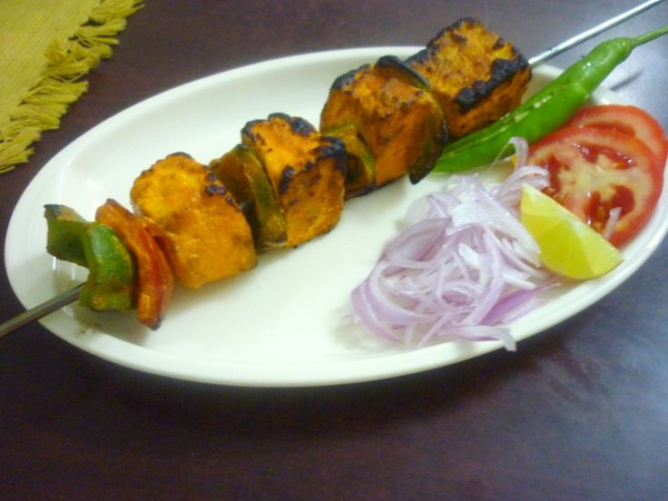 Paneer Tikka- soft juicy cubes of cottage cheese marinated in tandoori masala and grilled with fresh vegies.. a good starter! #VeganDishes