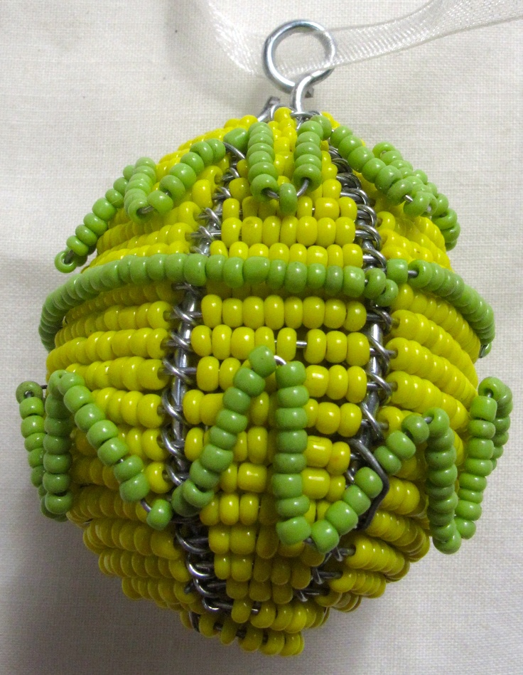 Beaded wire art egg, with green zigzags, about 6cm, $8