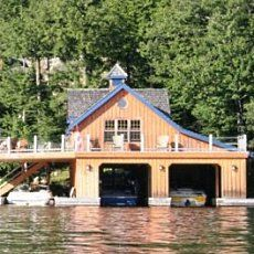 cute little cabin with a huge boat house beneath i like it