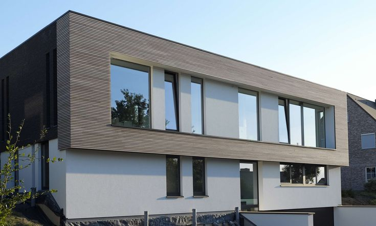 Gevelbekleding ceder free willy-Project VD Oudenaarde _I.r.-Architect Leen Dhaese (6).jpg 3.413×2.052 pixels