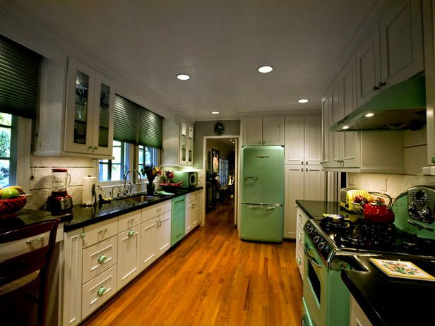 This kitchen blends vintage looking appliances with clean, contemporary cabinetry. Mint-green hardware pulls the look together.