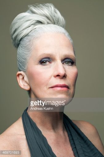 Stock Photo : Mature woman with grey haired bun, portrait.