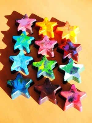 Recycled crayon stars!  Love making new funky crayons, just remove the paper from the old crayola craons, break into little pieces place the pieces in a silicon baking tray of any shapes (dollar store) then bake at 250-300 for a few minutes. Let cool and pop them out!! -- house smells a bit afterwards, but the crayons have a new life!