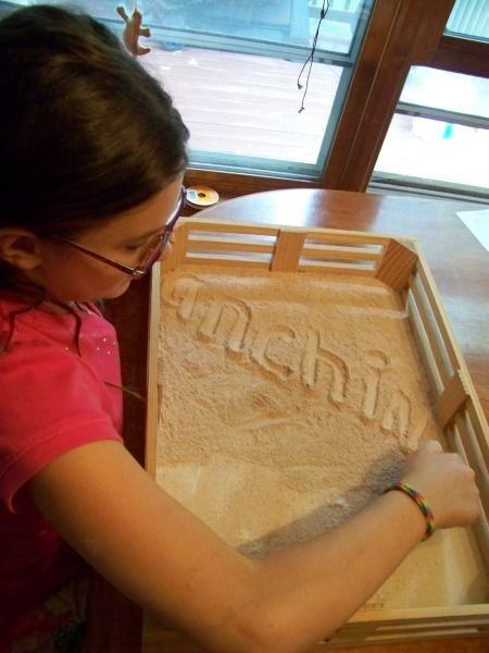 Use flour mixed with spices for a fun way to practice writing -- great for kids of all ages and they can mix their own wonderful scents!