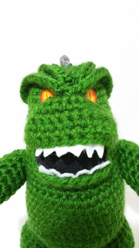 There is no one like him on Etsy, maybe it can throw its nuclear rays but his malevolent eyes come from the depths of Mordor GODZILLA  Height: 8,2 INCHES Width: 9,4 INCHES (BODY AND TAIL) Machine washable No bleach Dry cleanable 100% Acrylic  ************************************************** *****************************  To see more items from kutuleras click on the following link:   http://www.etsy.com/shop/Kutuleras   ************************************************** ...