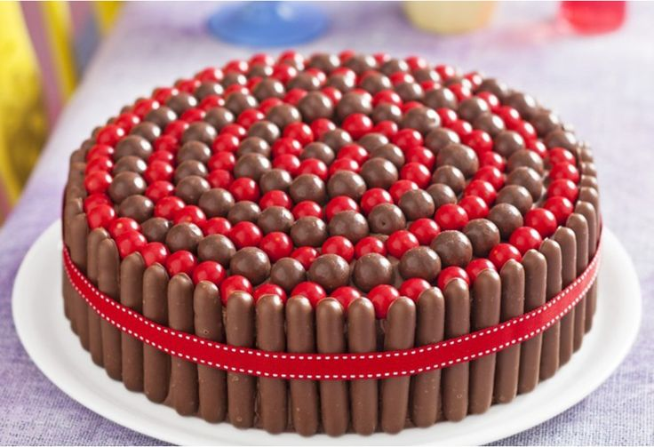 Get the kids to help decorating this moreish cake that's studded with Jaffas and…