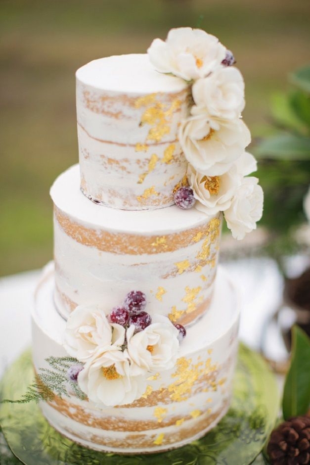 Semi Naked wedding cake with flowers and gold foil | half dressed wedding cake #weddingcake #nakedweddingcake #unforstedweddingcake #rusticweddingcake #weddingcakeideas