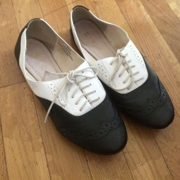 Restricted Shoes size 10 Shoes the the brand Restricted. Black and white flat shoes with shoe laces.Size 10. cute paired with jeans or a dress! good condition! Restricted Shoes