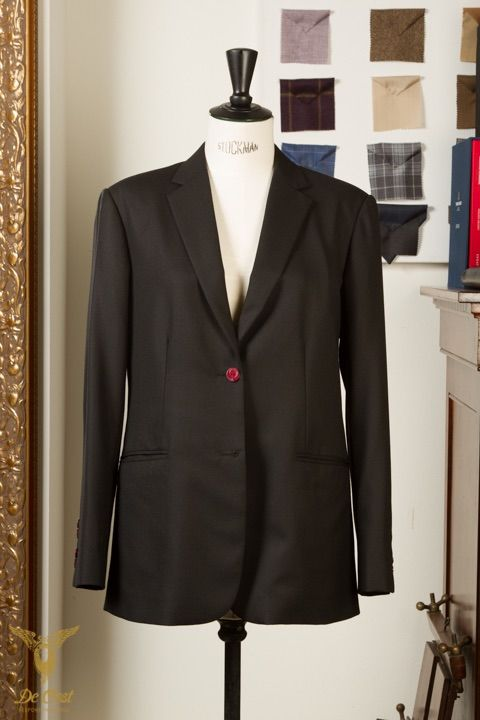 2 Button Black Herringbone Ladies Suit With Red Accents And A Personalised Cuff. With Notch Lapels And Straight Pockets.