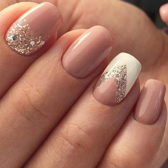I like this nail shape and the glitter.  I don't like the white strong v shape at e60 Nail Art Ideas To Make You Look Trendy And Stylish